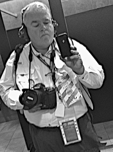A pretty horrible self-portrait made after shooting qualifying. Note the Racing Electronics headphones and radio, along with over-the-wall pass, general pass, Nikon D3s, etc.